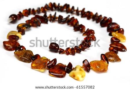 Amber necklace isolated on white - stock photo