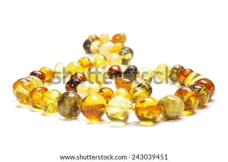 Amber necklace low angle isolated on the white background - stock photo