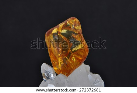 Amber on rock crystal - stock photo