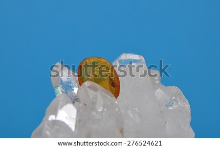 Amber on rock crystal - stock photo