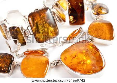 amber, transparent solar stone, close, silver frame - stock photo