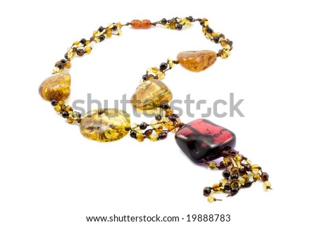 Amber with red gem - stock photo