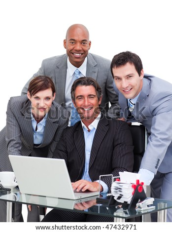 Ambitious business team working at a computer against a white background