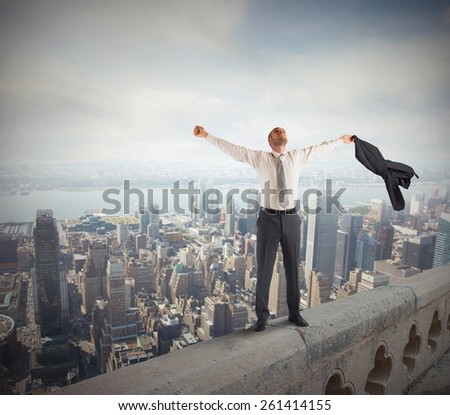 Ambitious businessman arrived at the success peak - stock photo