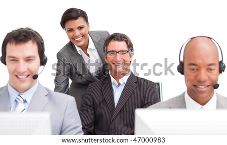 Ambitious customer agent team working in the office against a white background