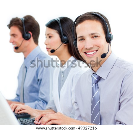 Ambitious customer service agents working in a call center against a white background