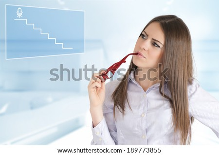 Ambitious girl dreams of director's chair - stock photo