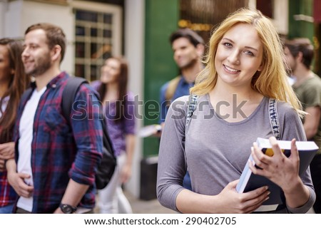 Ambitious student holding her books  - stock photo