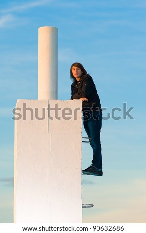 Ambitious teenager about to reach the top - stock photo