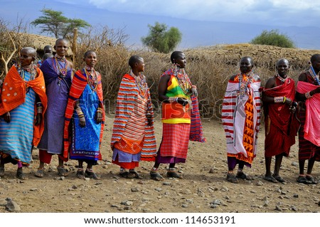 AMBOSELI, KENYA - OCT 13: Group of unidentified African men from Masai tribe prepare to show a traditional Jump dance on Oct 13, 2011 in Masai Mara, Kenya. They are nomadic and live in small villages. - stock photo