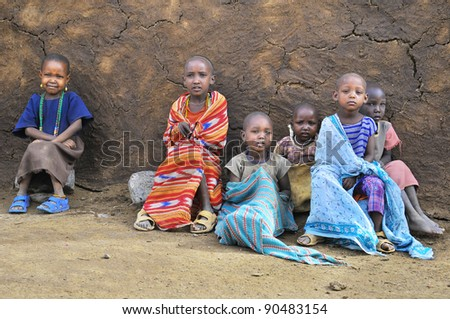 AMBOSELI, KENYA - OCT 13: Young unidentified African children from Masai tribe living in house made with cow dung on Oct 13, 2011 in Masai Mara, Kenya. - stock photo