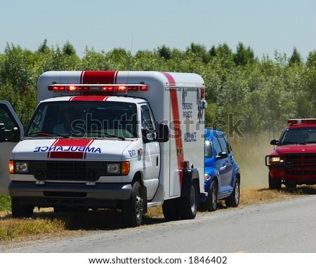 Ambulance at accident scene - stock photo