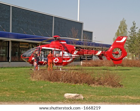 Ambulance helicopter landed to collect the patient - stock photo