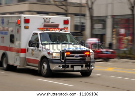 Ambulance in motion - stock photo