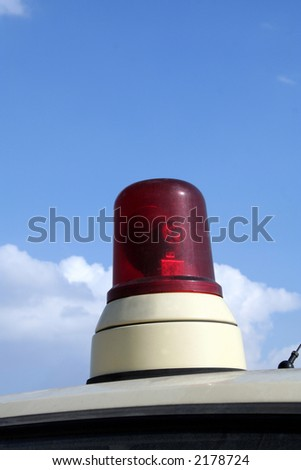 Ambulance light on a sky background - stock photo