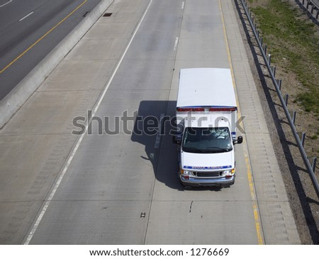 Ambulance on the Highway (Wide Angle) Top View with Copy Space on the Side - stock photo