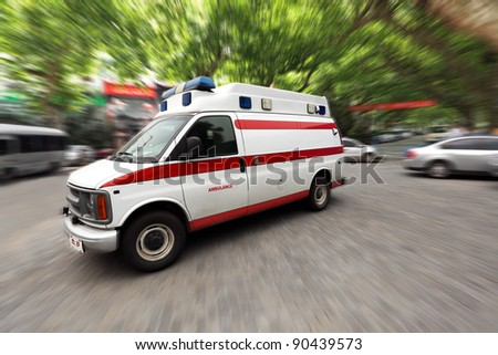 ambulance speeding on the street - stock photo