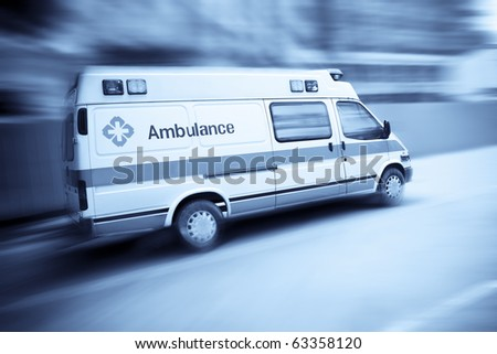 ambulance speeding with blurred motion - stock photo