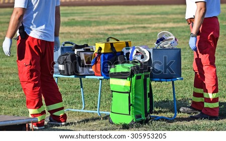 Ambulance staff with medical equipments - stock photo