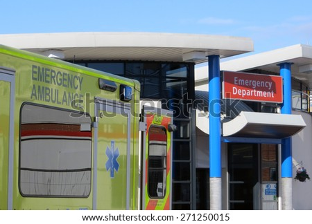 Ambulance vehicle parked outside of hospital emergency department - stock photo