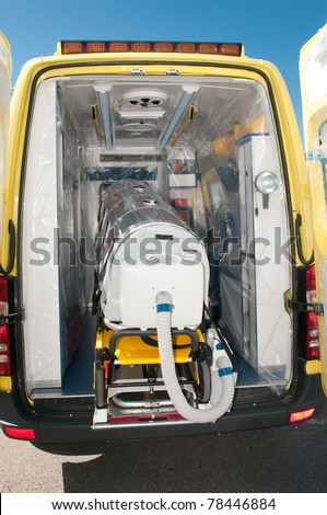 ambulance with special bed for ebola or virus - stock photo