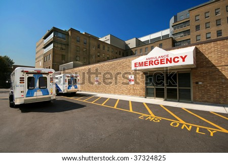 Ambulances wait outside the emergency department of a big city hospital - stock photo