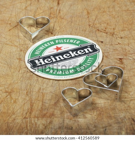 AMELAND, HOLLAND - April 24, 2016.: Beer mat from Heineken Lager Beer in vintage background , it was first brewed by Gerard Adriaan Heineken in 1873