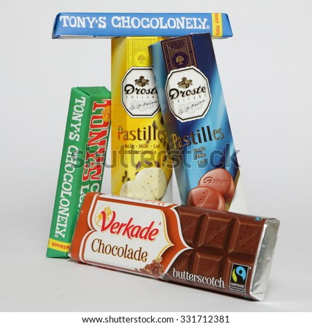 AMELAND, HOLLAND - OCTOBER 18, 2015: Tonys Chocolonely milk chocolate and many other. Fair trade chocolate made by Tonys Chocolonely chocolate factory in Amsterdam, Netherlands.