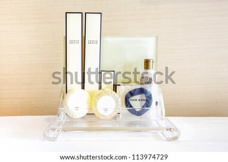 Amenities kit on shelf in bathroom - stock photo