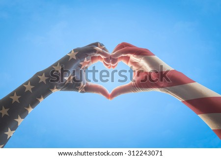 America flag pattern on people hands in heart shaped form against vintage color tone sky background : USA Independence day, Happy Columbus day, patriot day, constitution and citizenship day   - stock photo