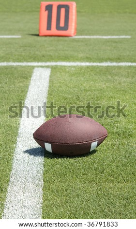 America Football field with ball on first down and ten yard line. - stock photo
