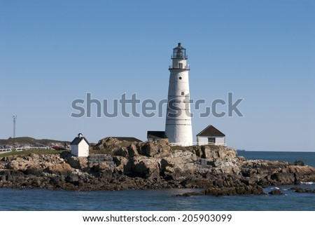 America's oldest lighthouse, Boston Harbor light, is a favorite summertime attraction for tourists. - stock photo