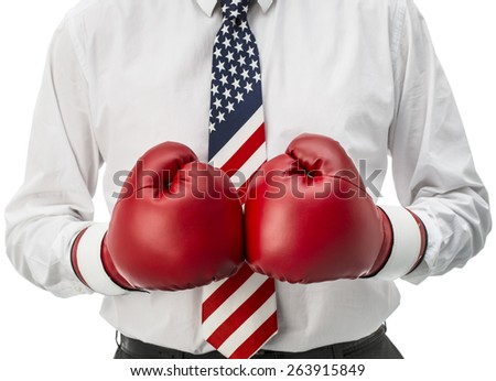 American aggressive businessman isolated on white  Businessman with United States of America flag and red boxing gloves - stock photo