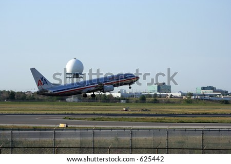 American Airlines taking off - stock photo