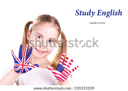 American and English flags on child's hands. Learning English language concept. - stock photo