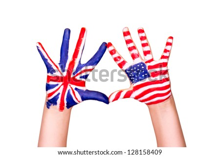 American and English flags on hands. Learning English language concept. - stock photo