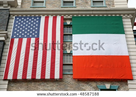American and Irish flags hanging on an old building - stock photo