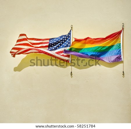 American and rainbow flags waving on a wall. Concept of equality and non discrimination - stock photo
