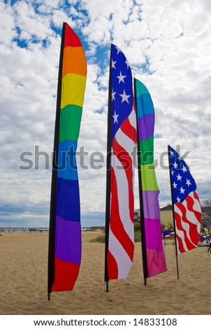 American and rainbow gay pride flags on the beach at Provincetown, Massachusetts, USA - stock photo