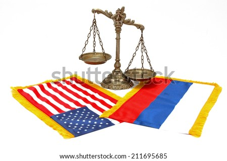 American and Russian flag with decorative scales of justice on white background, concept of sanctions - stock photo