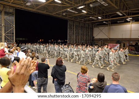American Army soldiers (Air Cavalry 4-6, 2nd ID, Fort Lewis, WA) return home August 22, 2008 after over a year of deployment in Iraq. Editorial. - stock photo