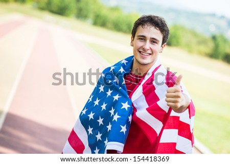 American Athlete with National Flag - stock photo