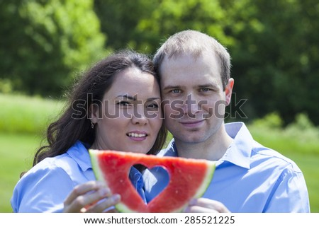 American  attractive couple with watermelon at summer