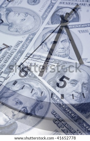 American banknotes and clock face. - stock photo