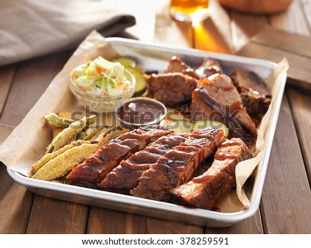 american barbecue platter with ribs, brisket and fried okra - stock photo