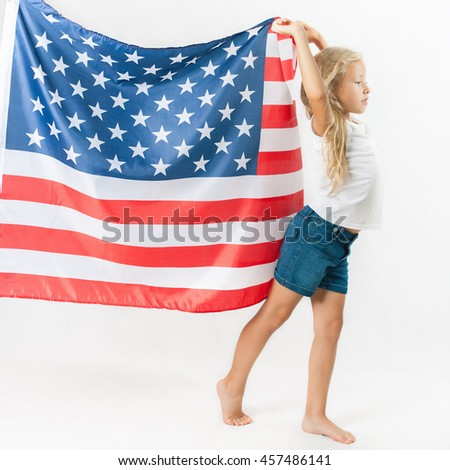 American blonde girl holding American national flag and walking. USA. Patriot. School child. Back to school. Fan. White background - stock photo