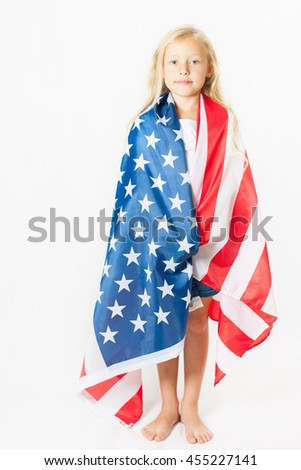 American blonde girl holding American national flag. USA. Patriot. School child. Back to school. Fan. White background - stock photo