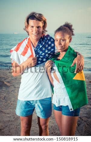 American Boy with Brazilian Girl at Beach - stock photo