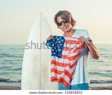 American Boy with Surf Board - stock photo