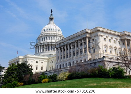 American Capitol Hill Building with tree and blue sky, Washington DC, USA - stock photo